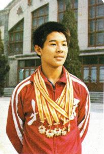 Li Lanzie su jo olimpiadoje laimėtais medaliais.